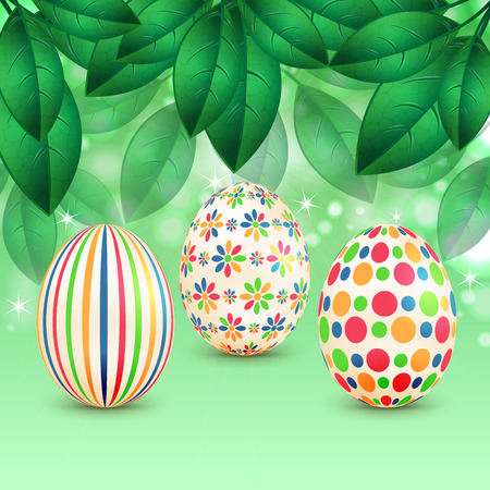 Easter eggs with colorful patterns on a background of spring foliage