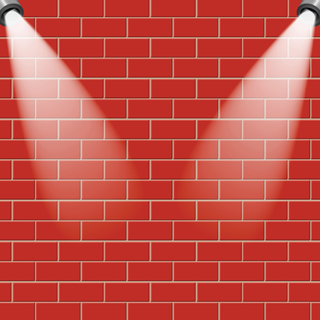 Red brick wall is illuminated by the rays of light.Empty brick wall with a place for your design