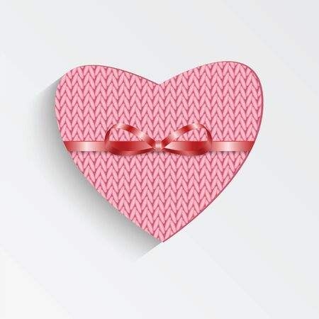felicitation: Gift card in the form of heart for Valentines day.Knitted pink heart with  ribbon