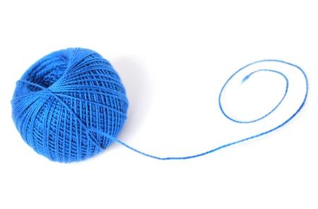 a ball of blue thread with a curl of photo