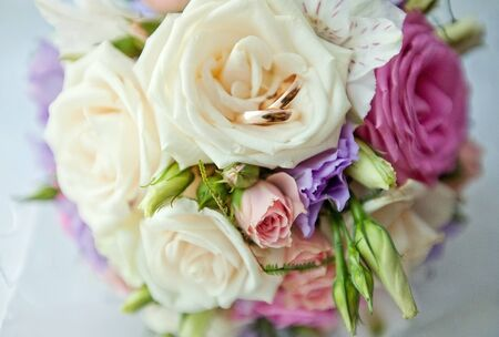 Bridal bouquet of roses and rings photo