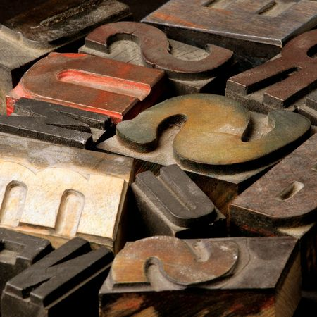 monotype: Old wooden printing type.  Focus in the middle. Stock Photo