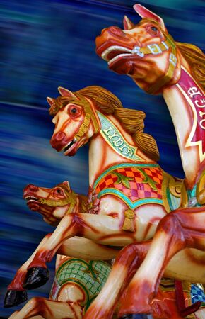 Three horses of a merry-go-round. Focus is on the middle horse. photo