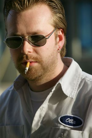 A smoking labourermechanicworkman named Ollie. photo