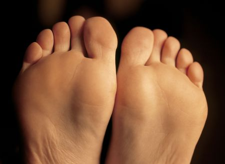 Shallow depth-of-field image of the bottom of a females feet. photo