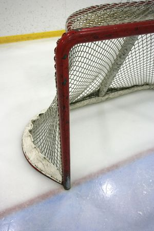 Goal post and net in a hockey arena. photo