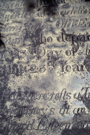 distressed: An old distressed and eroded epitaph.  Found in a gravesite in Boston. Stock Photo