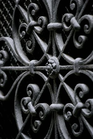 A background image of decorative wrought iron with short depth of field.