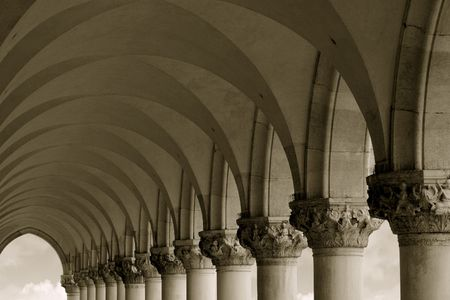 sightsee: Sepia-toned row of arches and columns in Venice Italy.