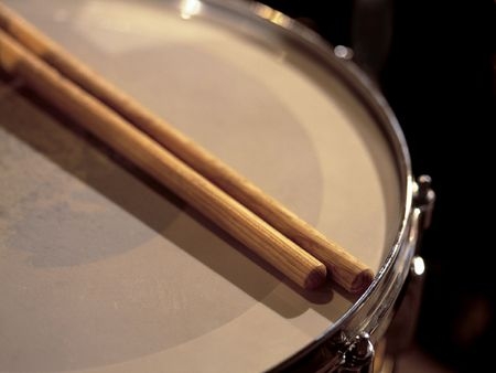 percussionist: Drumsticks resting on a snare drum between sets of a live show. Stock Photo
