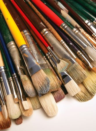 daubs: A bunch of used paintbrushes.