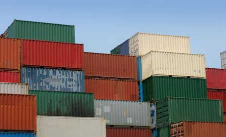 consignment: Shipping containers waiting to be loaded on a cargo ship.