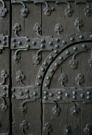 ironwork: Section of an old gothic door showing the ironwork.  (in Brussels, Belgium)