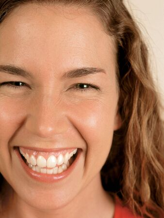 Closeup of a laughing naturally beautiful woman with green eyes. Stock Photo - 490118