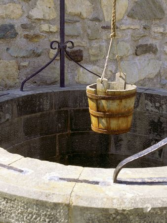 A water well with an old bucket in Fort Louisburg, Nova Scotia, Canada. photo