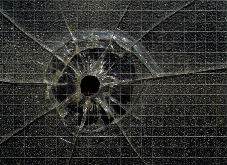 vandal: A bullet hole in industrial security glass. Stock Photo