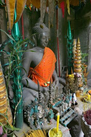 idolatry: Buddha in Cambodia surrounded by offerings.