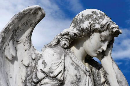 Statue of an sad angel.  Sculpture was on top of a gravestone from the 1800's. 스톡 콘텐츠