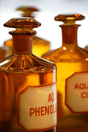 An image of vintage chemical bottles in a pharmacy. Stock Photo
