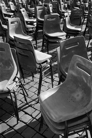 lonliness: Stacked plastic chairs in Vatican city after the Pope made an appearance.