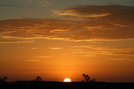 outback australia: An image of the Australian Outback landscape during a sunset. Stock Photo