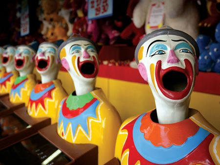 fairground: A row of clowns at an amusement park game.