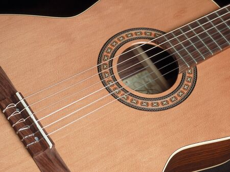 virtuoso: Closeup image of a classical guitar.