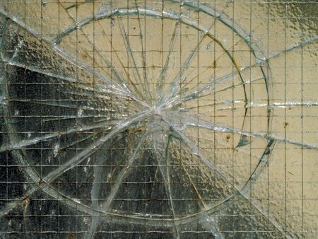 Smashed window pane with security wire. Stock Photo - 490132
