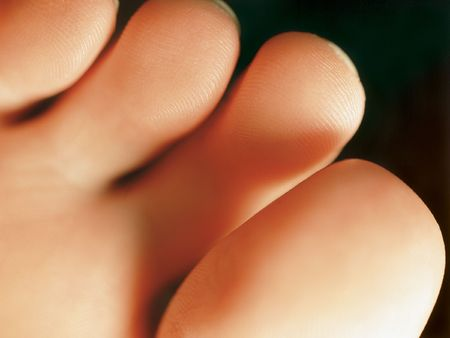 foot fetish: Macro photo of the bottom of a females healthy toes. Shallow depth-of-field. Stock Photo