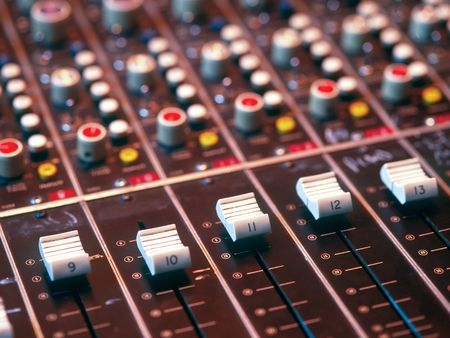Mixing console in a recording studio photo