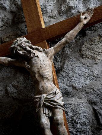 crucify: Sunlight through a church window lighting Jesus on the cross.