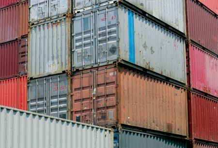 payload: Shipping containers waiting to be loaded on a cargo ship.