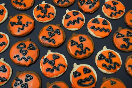 Creepy pumpkin cookies straight out of the oven. photo