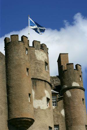 scottish flag:  The Scottish flag flying above a castle.