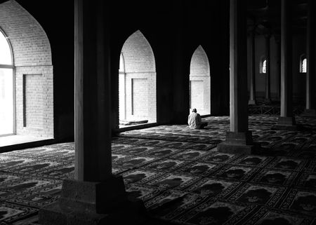 Praying in a Mosque in Kashmir, India photo