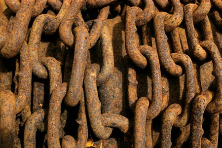 rusty background: Background image of a rusty pile of chain. Stock Photo