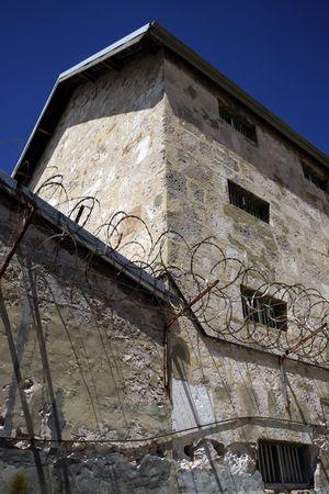 The walls and razor wire of Fremantle prison in Perth, Australia. Stock Photo - 755106