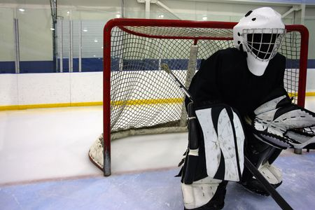 scored: Goalie waiting for the action to come their way. Stock Photo