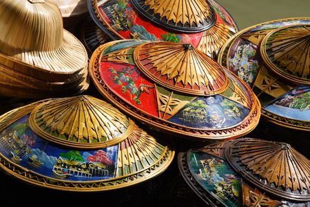 hundreds: Hundreds of souvenir hats piled high for tourists visiting Thailand to buy.