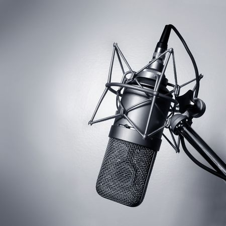 radio microphone: Black and white image of a studio microphone.