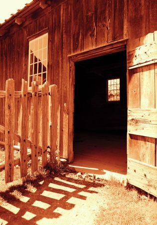 Old photo of an old barn.  Scanned from black and white film and warm tones added. photo