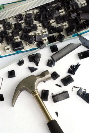 An image of computer frustration. I bashed my keyboard with a hammer, then took pictures. Stock Photo - 900718