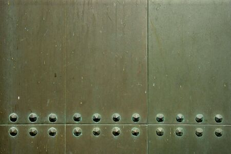 rivets: Background  industrial image of metal plates with old rivets.