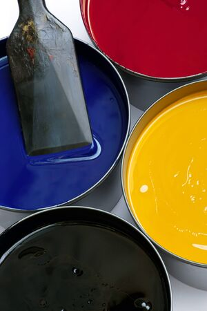 publishes: Tubs of printing press inks, cyan, magenta, yellow and black.  An ink knife rests in the cyan container.