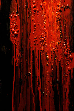 blood smear: Image of blood and guts splattered against a black surface.  Background image for horror  , etc.