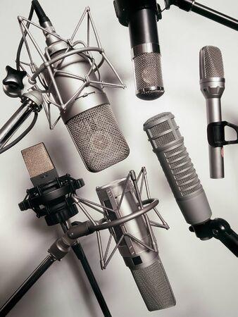 recording studio: A series of recording studio microphones.  Slightly desaturated. Stock Photo