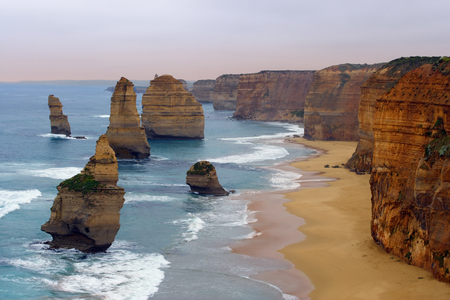 The Twelve Apostles along the Great Ocean Road, Australia.  Photo was taken in December 2004 before the apostle in the front had fallen. photo