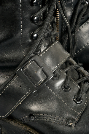scuff: Background image of well worn, dirty, scuffed black boots. Stock Photo