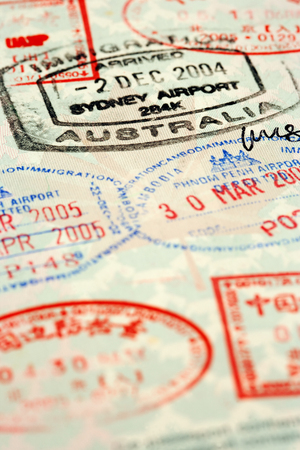 Macro / selective focus image of passport stamps.  Focus is on the word Australia. Stock Photo - 1585574