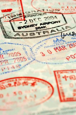 Macro / selective focus image of passport stamps.  Focus is on the word Australia. Stock Photo - 1585574